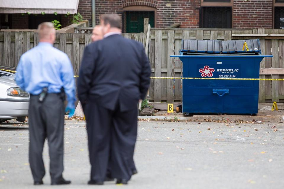 Police investigated the area behind 599 Columbus Ave. where the bodies of two men were discovered behind a trash receptacle. Foul play was not suspected.