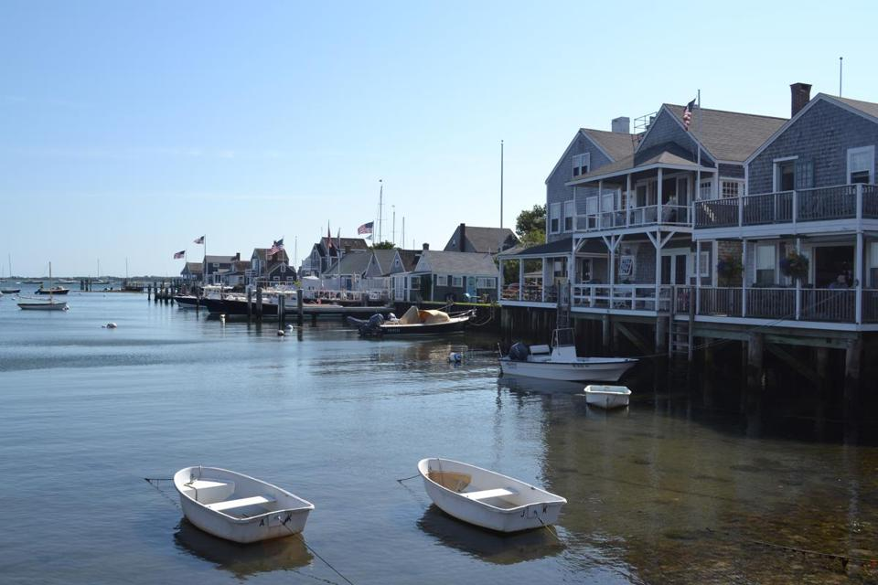 Nantucket Harbor, lined with gray-shingled cottages, is an idyllic souvenir shot.