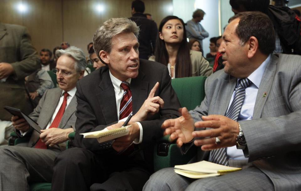 US envoy Chris Stevens, center, is seen conferring with Dr. Suleiman Fortia, a Libyan opposition leader, in Benghazi, Libya, on April 11, 2011.