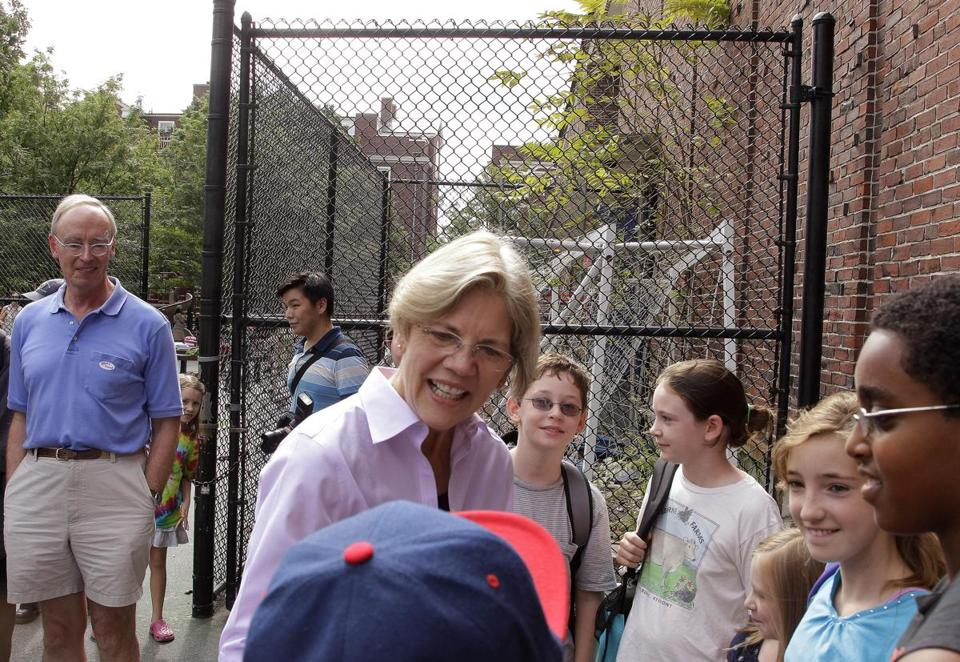Elizabeth Warren talked to children on a playground after voting in the Massachusetts state primary election on Thursday, Sept. 6.