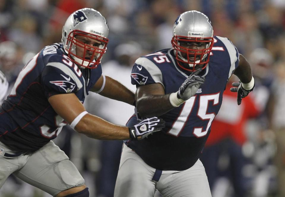 New England Patriots linebacker Rob Ninkovich and Vince Wilfork pursue the playin 2012.