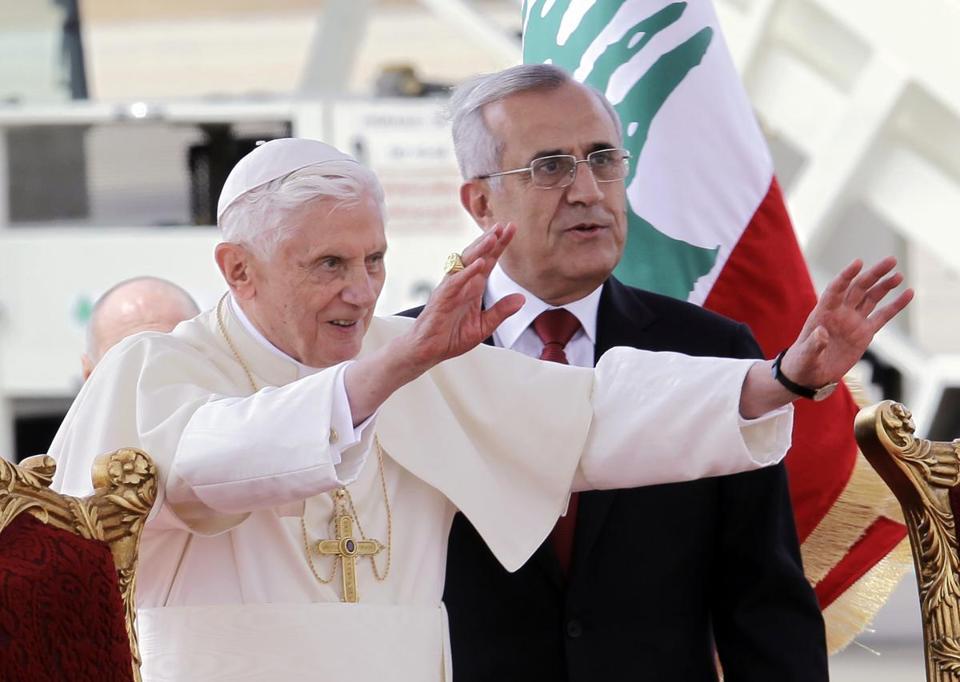 Pope Benedict XVI stood next to Lebanese President Michel Suleiman as he waved to the crowd at Rafik Hariri international airport, in Beirut, Lebanon, on Friday.