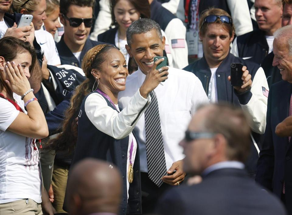 Olympic sprinter Sanya Richards-Ross, a gold medalist, took pictures with President Obama as the 2012 US Olympic and Paralympic teams visited the White House.