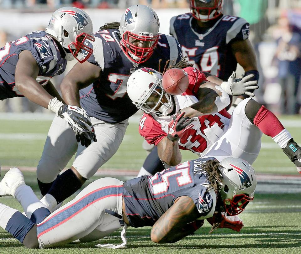 Cardinals running back Ryan Williams coughed up the ball with aboutaminute left to give the Patriots a chance to pull out the win, butamissed field goal got Williams off the hook.