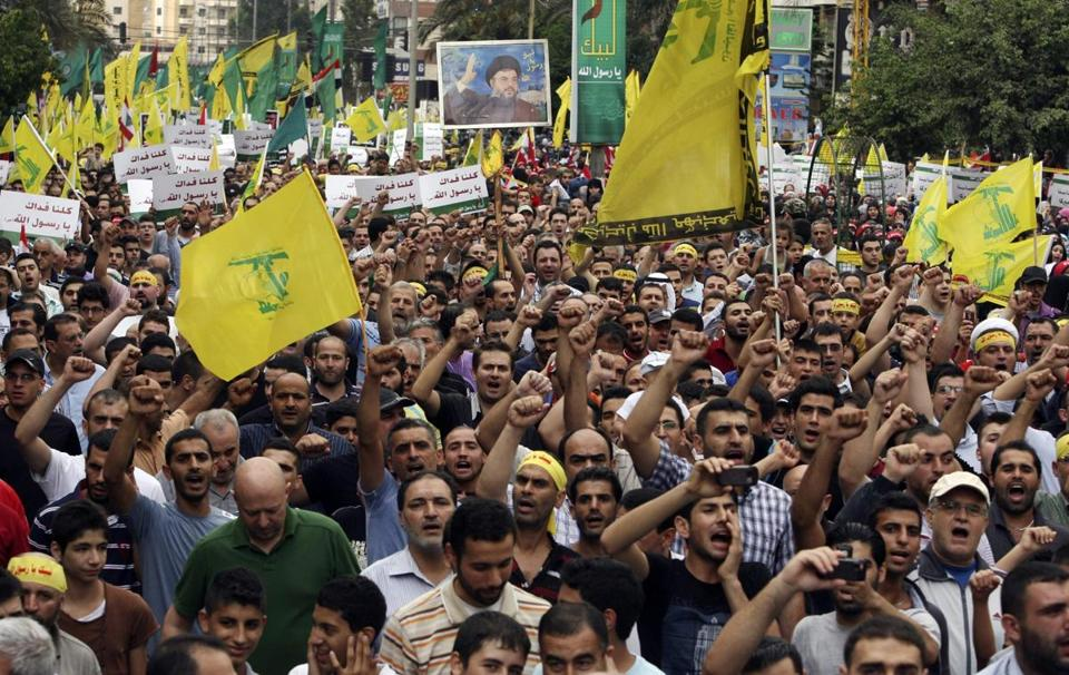 Supporters of Lebanon's Hezbollah shouted slogans as they marched at an anti-U.S. protest in Beirut's southern suburbs.