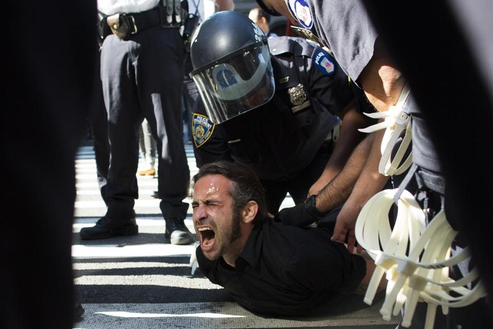 Occupy Wall Street protester Chris Philips screamed as he was arrested near Zuccotti Park on Monday.