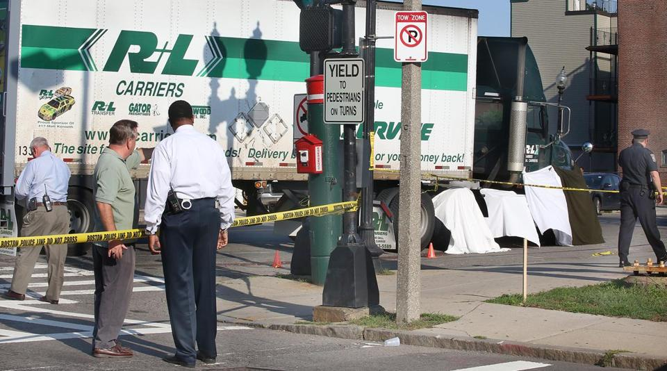 White sheeting hid the body of a woman who was killed by a tractor-trailer in South Boston Monday.
