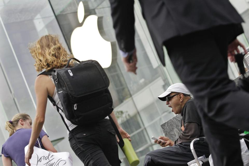 Hazem Sayed yawned while waiting outside an Apple store Tuesday for the iPhone 5 to go on sale on Friday.