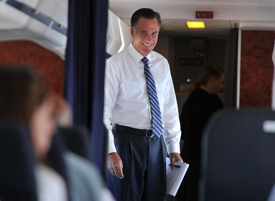 Mitt Romney spoke with aides aboard his plane on the way to Salt Lake City to attend a fundraising event on Monday.
