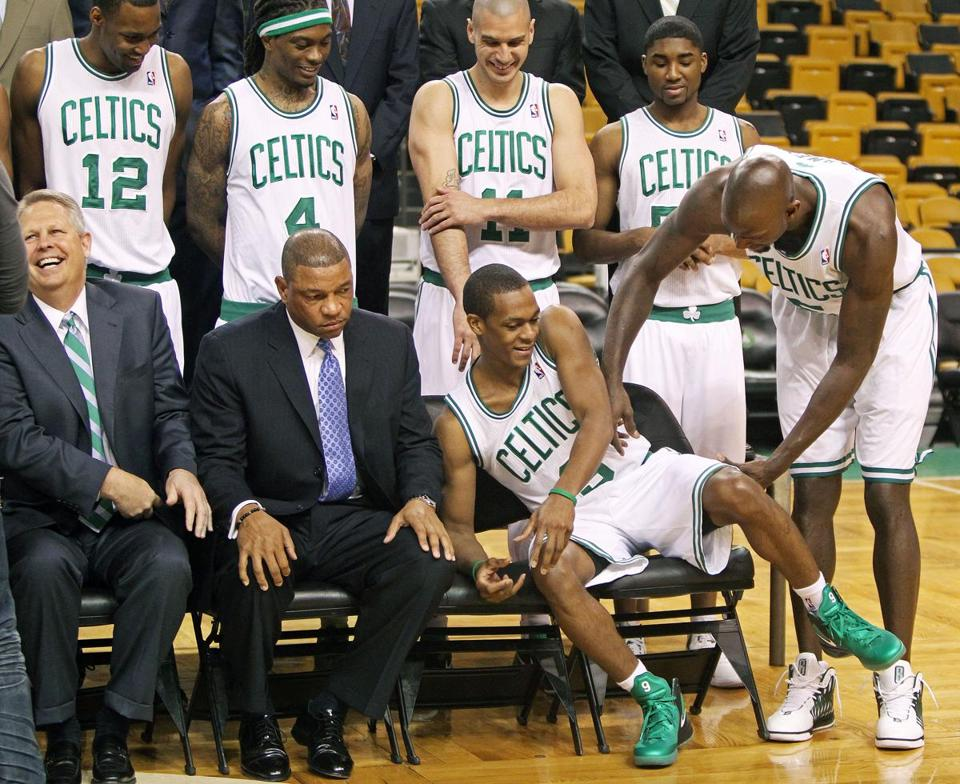 Doc Rivers can get his players to perform. Getting them to pose for a team photo is not as easy.