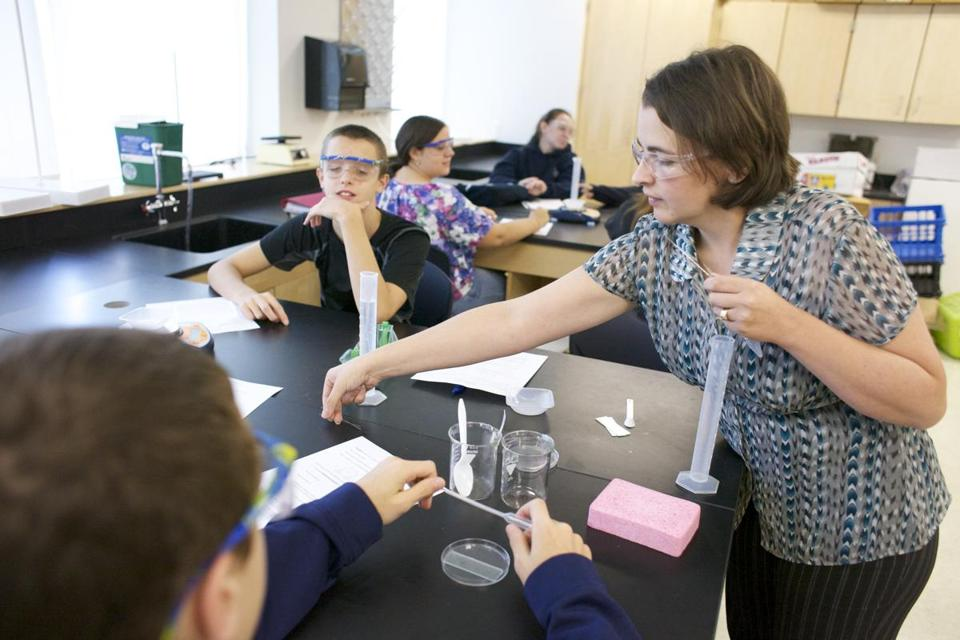 Teacher Angela Armstrong directs a water lab for Ryan Palmer, 14 (left), and other freshman biology students last week at Rockland High.