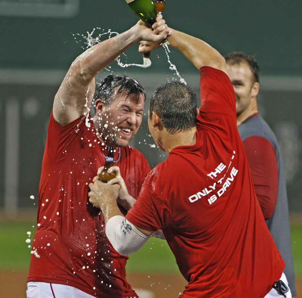 Sean Casey, left, and Kevin Cash celebrated the playoff bid after the game.