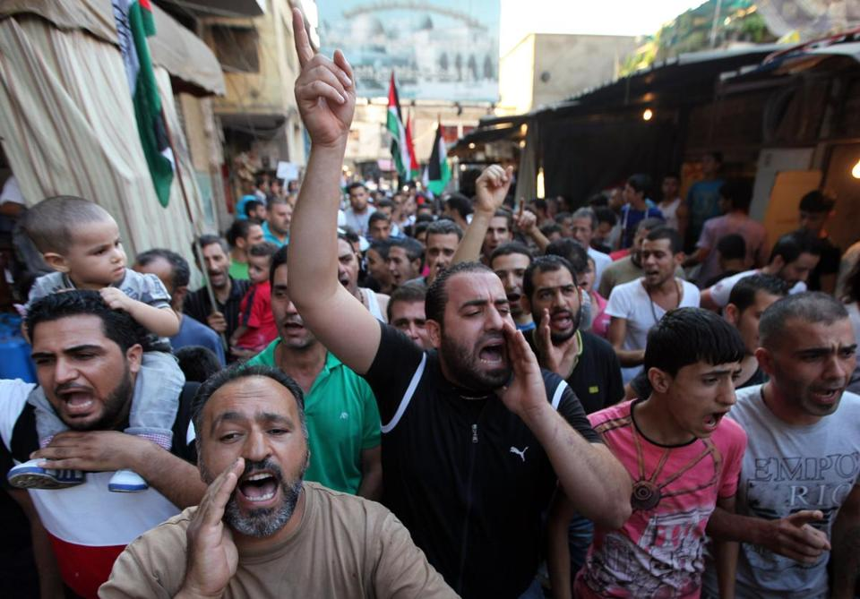 Palestinian refugees protest an anti- Islamic video on YouTube in Beirut, Lebanon, Thursday.