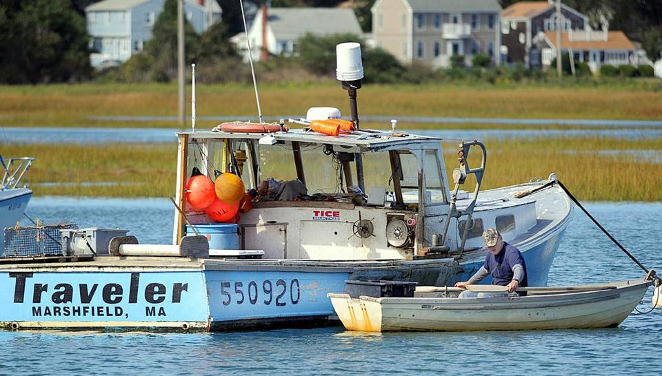 Fisherman Bob Tice gets in his skiff after mooring his boat in Green Harbor.
