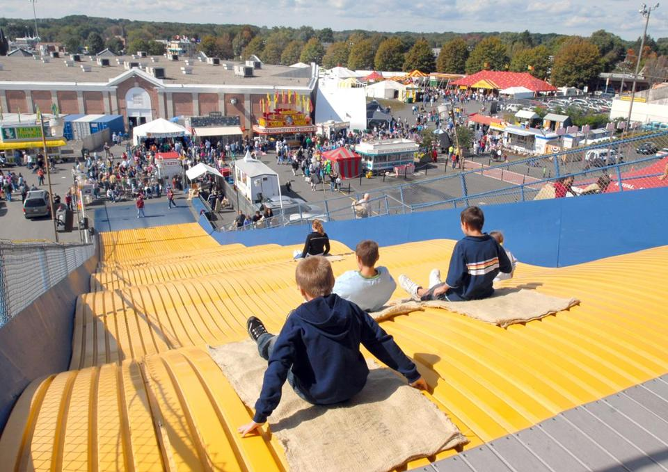 Fairgoers brave the giant slide at the the Big E fair in West Springfield.