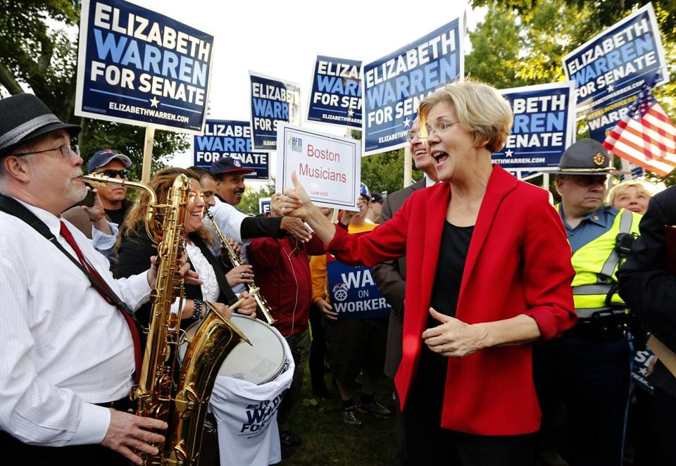 Elizabeth Warren greets supporters as she arrives for the debate.