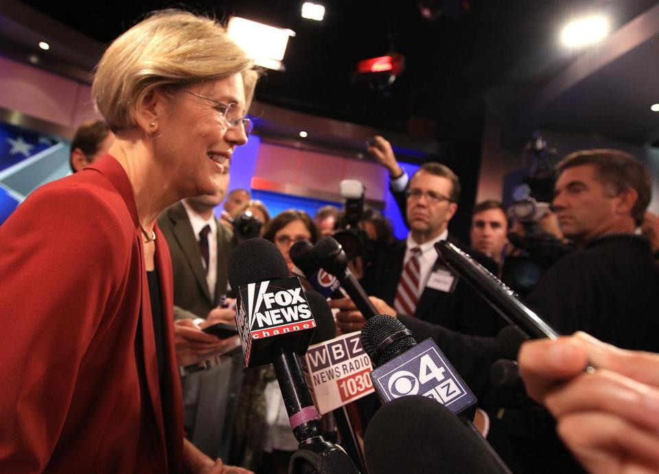 Senate candidate Elizabeth Warren spoke to reporters after debating incumbent Scott Brown last week. Brown has criticized Warren for her role in an asbestos case.