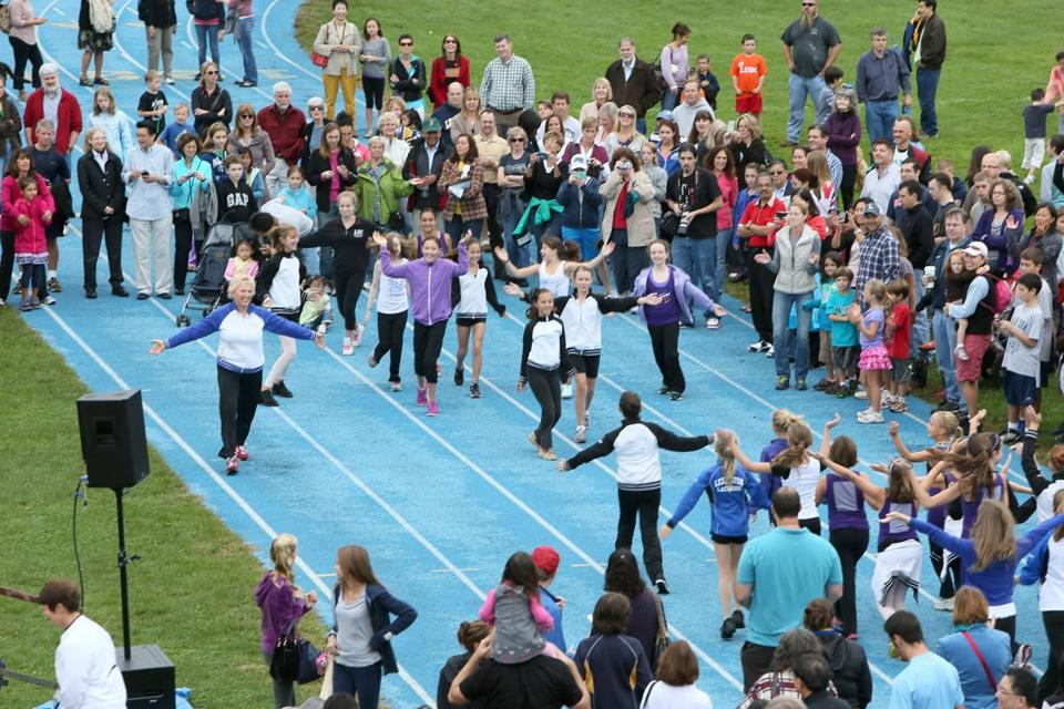 During a kickoff event Saturday for Lexington's 300th anniversary events, students from Dance Inn performed as residents gathered on the high school track for a group photo.