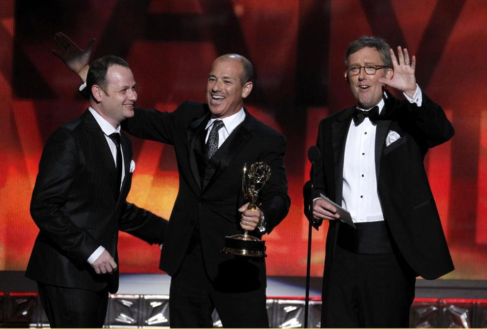 Alex Gansa (right) accepted the award for writing in a drama series along with Gideon Raff (left) and Howard Gordon at the 2012 Emmys.