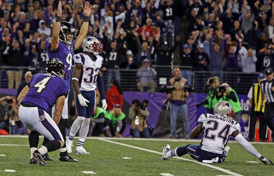 The Ravens' Justin Tucker signaled triumphantly after making good on a 27-yard field goal attempt as time expired to foil the Patriots, 31-30, Sunday night in Baltimore.