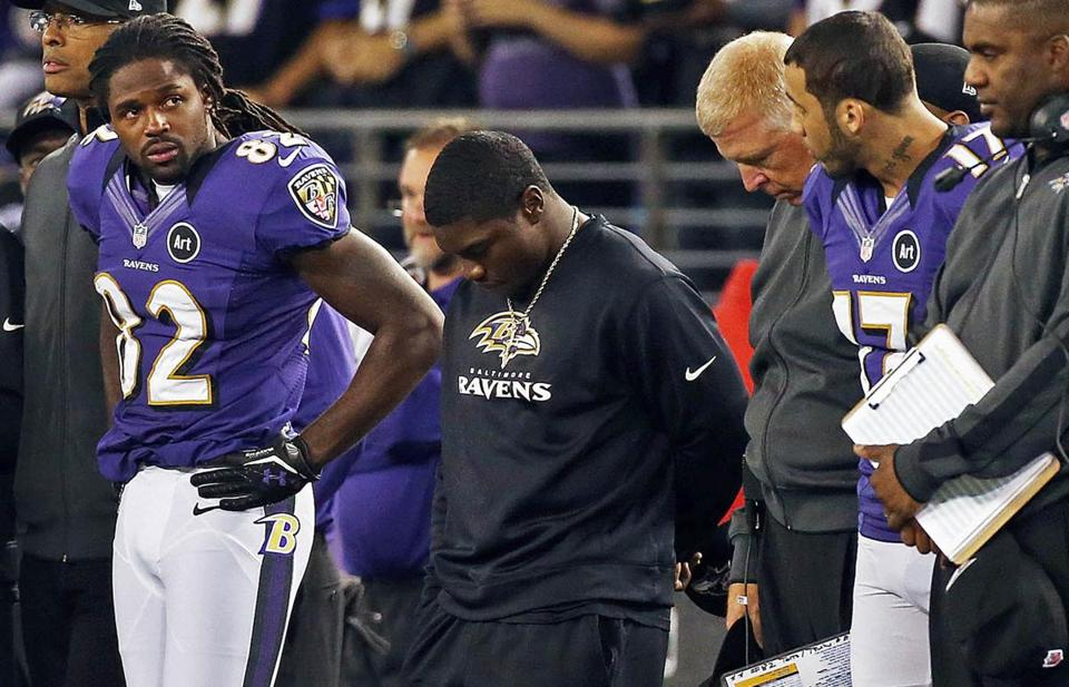 Torrey Smith (82) stands on the Baltimore sideline during a pregame moment of silence for his brother Tevin.
