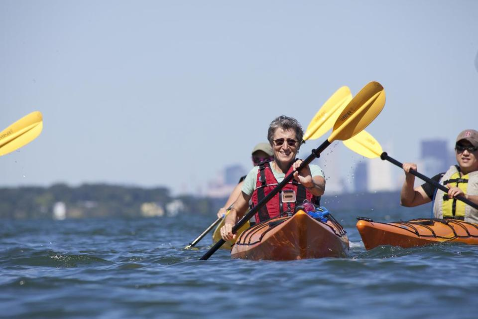 Sally Jewell, CEO of REI, took a break during a recent visit to check on stores in Greater Boston to kayak around Hingham Harbor.