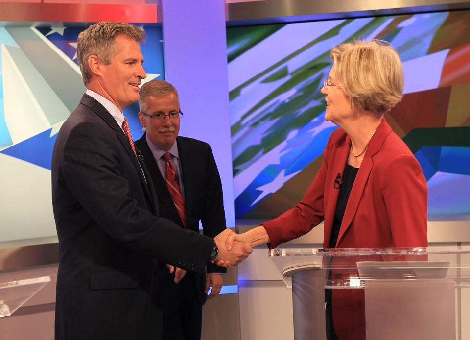 Scott Brown and Elizabeth Warren before the first debate, at WBZ-TV, with moderator John Keller in the background.