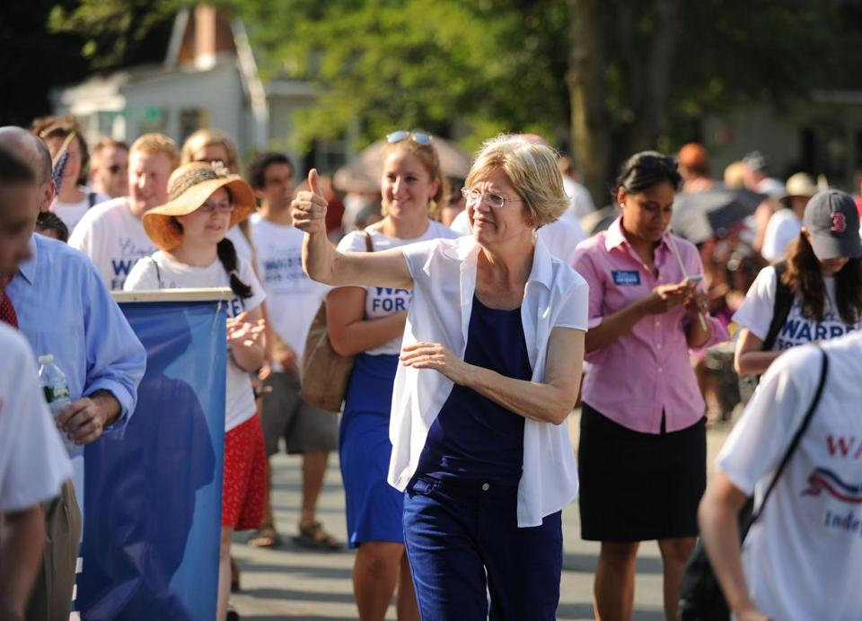 Elizabeth Warren greeted spectators during the Wakefield Fourth of July Parade.