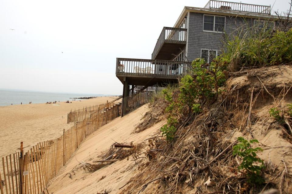 Owners of oceanfront homes on Annapolis Way on Plum Island have permits to allow beach scraping, in which sand is moved into a position to better protect their property.