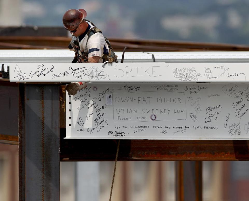 A worker connected a beam at the topping off ceremony at 11 Fan Pier Blvd. in July.