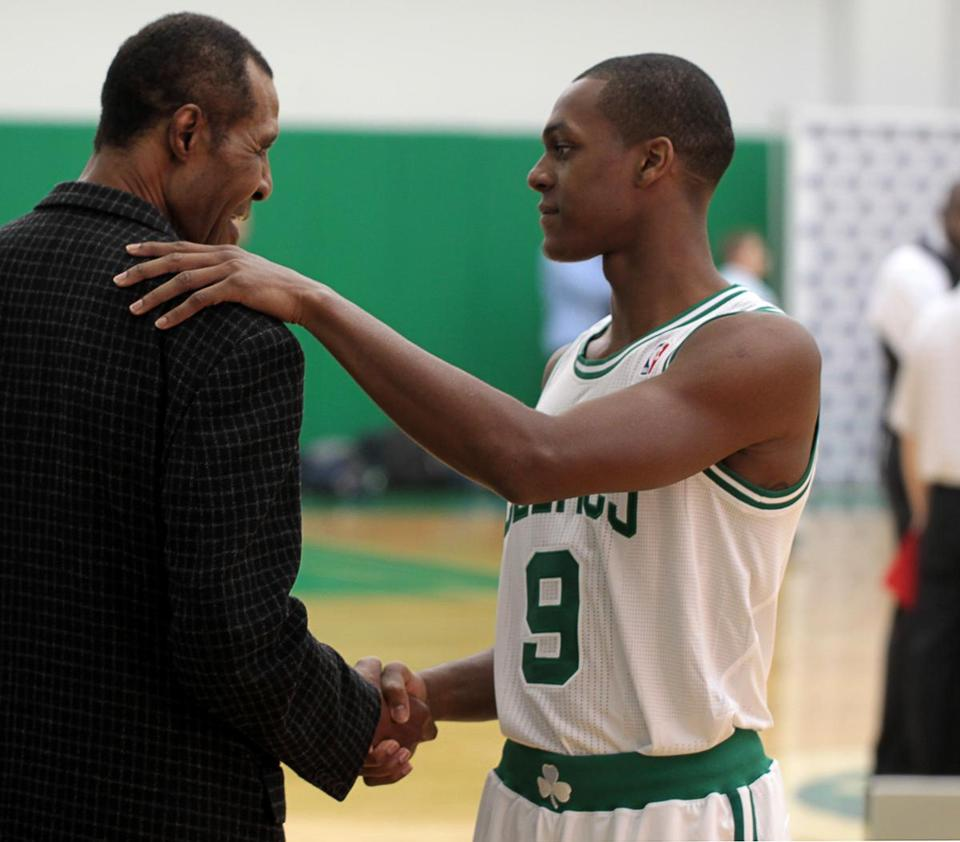 Former Boston Celtic player Jo Jo White and current starting point guard Rajon Rondo.