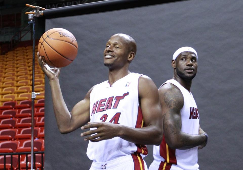Ray Allen donned his Heat uniform with LeBron James as the team opened training camp.