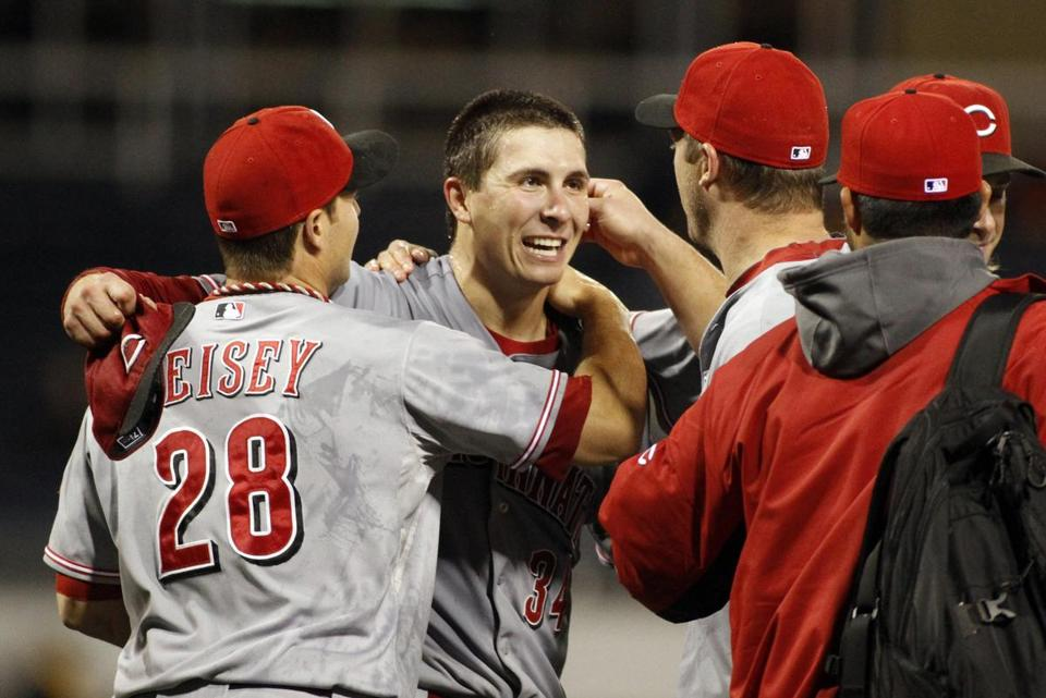 Homer Bailey was greeted by teammates after the game.