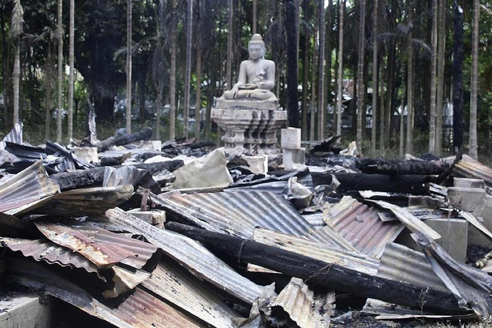 A derogatory photo of the Koran posted on Facebook triggered the burning of Buddhist temples Sunday.