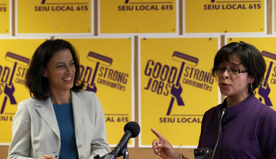 SEIU Local 615 attorney Ingrid Nava (left) and union president Rocio Saenz discussed details of the janitors contract Monday.