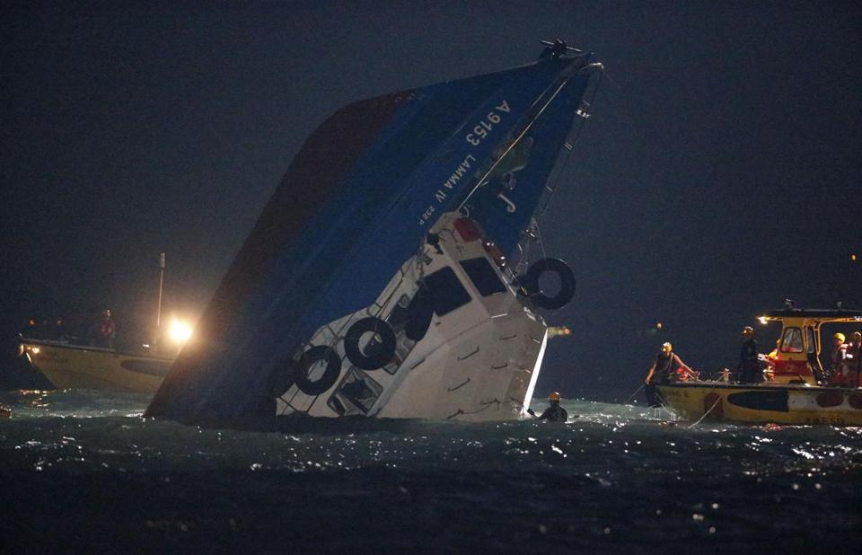 Rescue crews searched for survivors Tuesday after a boat carrying more than 120 holiday revelers struck a ferry off Hong Kong.