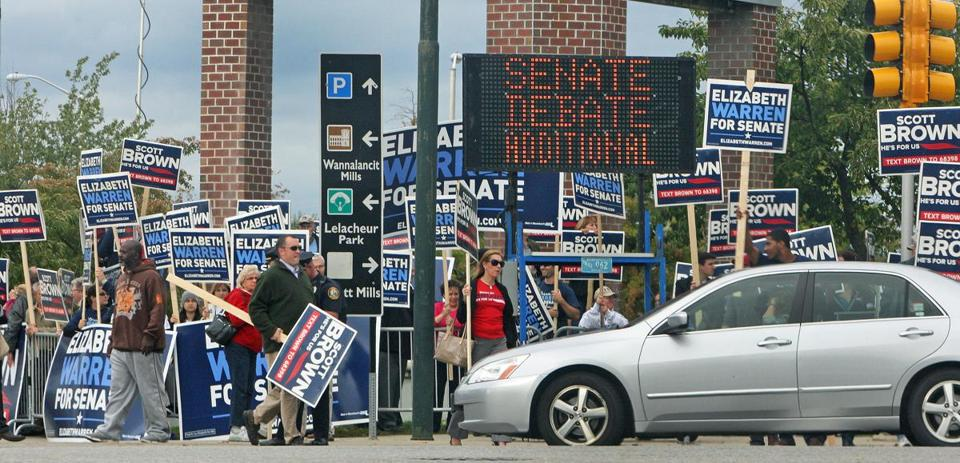 Three hours before the debate, sign-carrying supporters of both candidates stood outside the Tsongas Center at UMass Lowell.