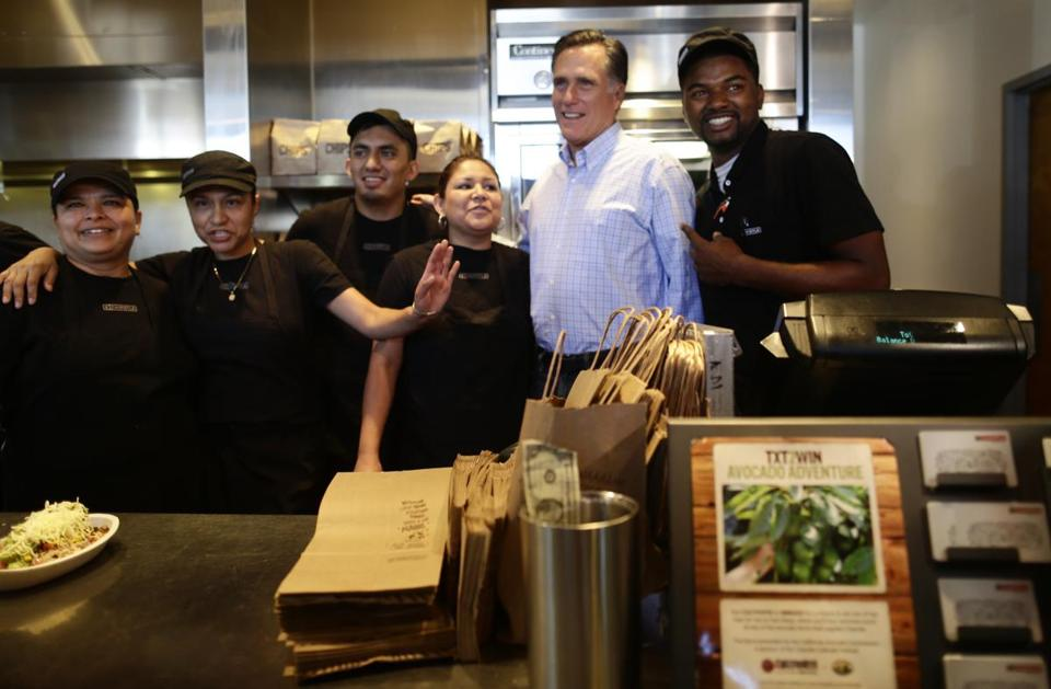 Mitt Romney posed with workers at a Chipotle restaurant in Denver on Tuesday.