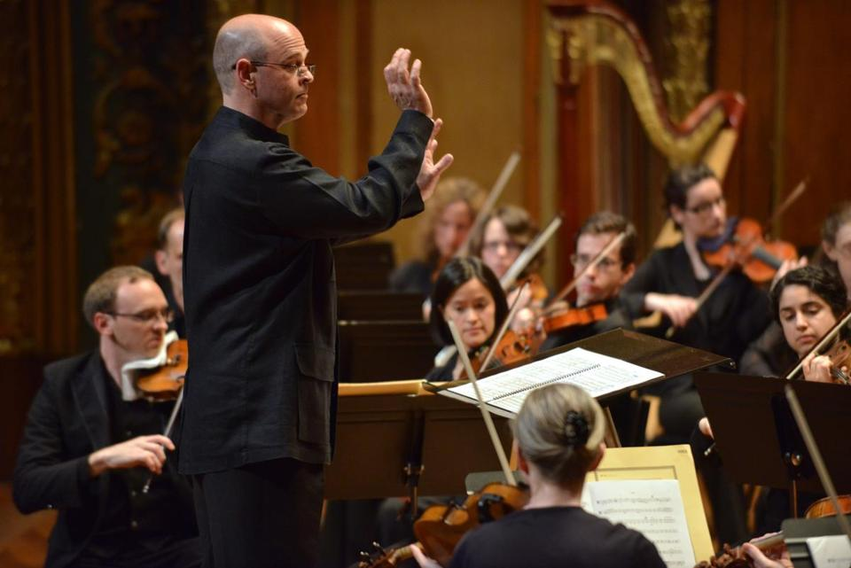 "Gil Rose (pictured conducting at Jordan Hall) will lead BMOP in a concert performance of ""The Midsummer Marriage."""