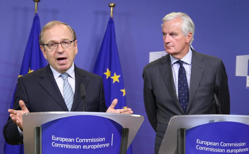 An EU panel led by Finnish bank official Erkki Liikanen (left) blamed excessive risk taking by banks for helping to create the financial crisis in Europe.