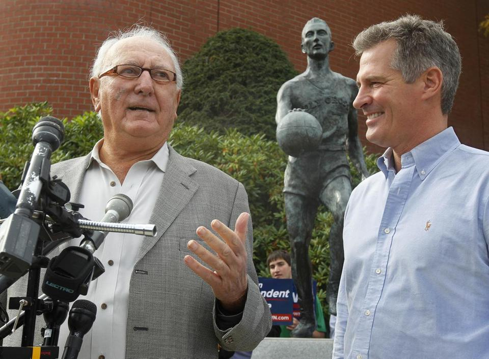 Boston Celtics legend Bob Cousy endorsed Brown during while standing in front of a statue of Cousy on the College of the Holy Cross campus in Worcester on Tuesday.