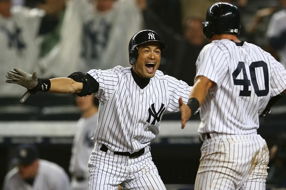 Ichiro Suzuki celebrated with Francisco Cervelli after he scored the winning run on a hit by Raul Ibanez in the 12th inning against the Red Sox.