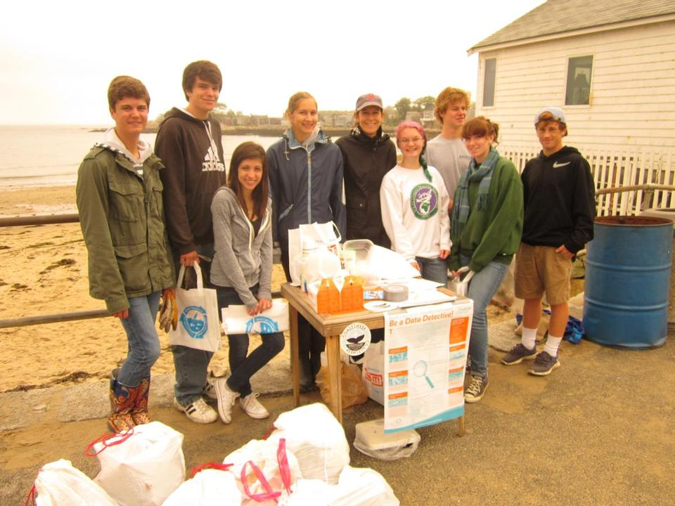 A COASTAL CLEANUP STORM — As part of Coastsweep, an annual series of volunteer efforts to remove debris from the shoreline, Rockport High School students, parents, and teachers last month helped clean up town beaches.