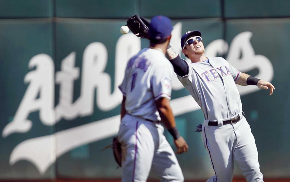 Josh Hamilton drops a fly ball in center field for a two-run error in Oakland's six-run fourth inning.