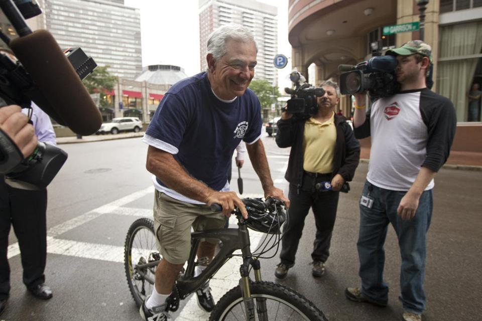 Bobby Valentine, hours after being fired, met with reporters after taking a bike ride.
