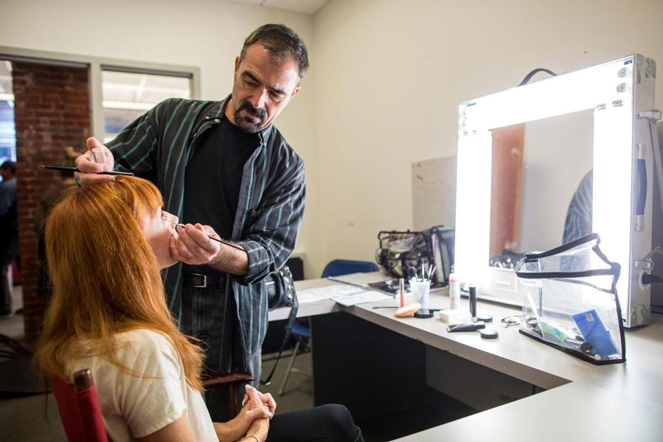 "Makeup artist Joe Rossi on the set of ""The Makeover,"" filming in Boston."