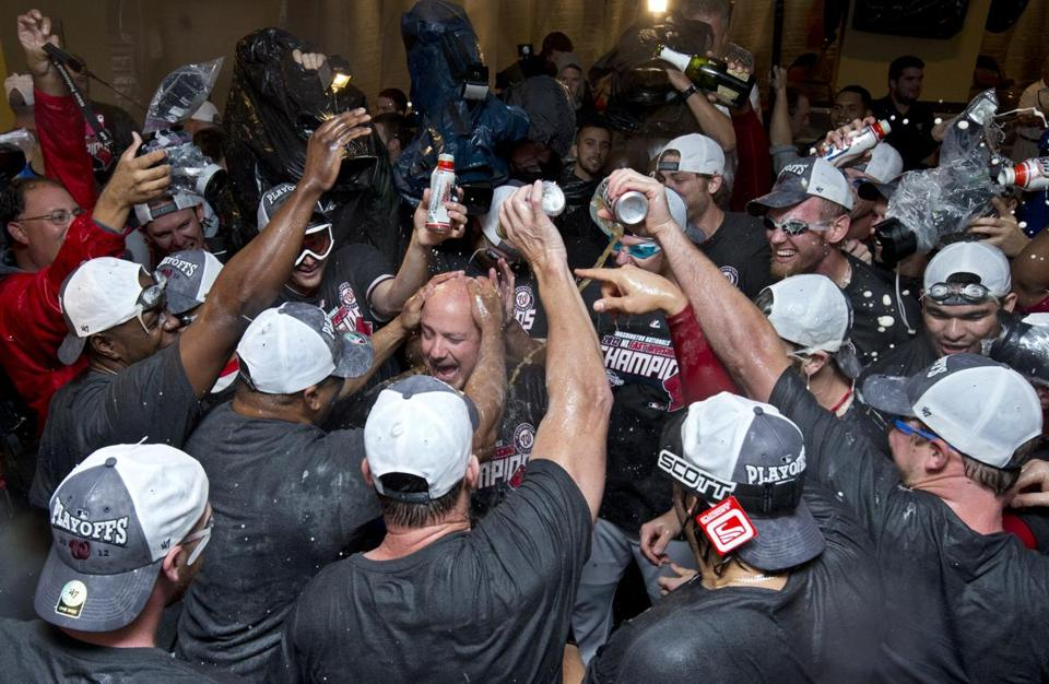 Nationals GM Mike Rizzo, appropriately, was at the cen­-ter of the celebration when they clinched the NL East.