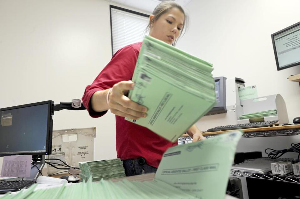 Karen Williams, a worker with Leon County, fed ballots into a machine at the elections office in Tallahassee, Fla. Mailed ballots are more likely to be contested.
