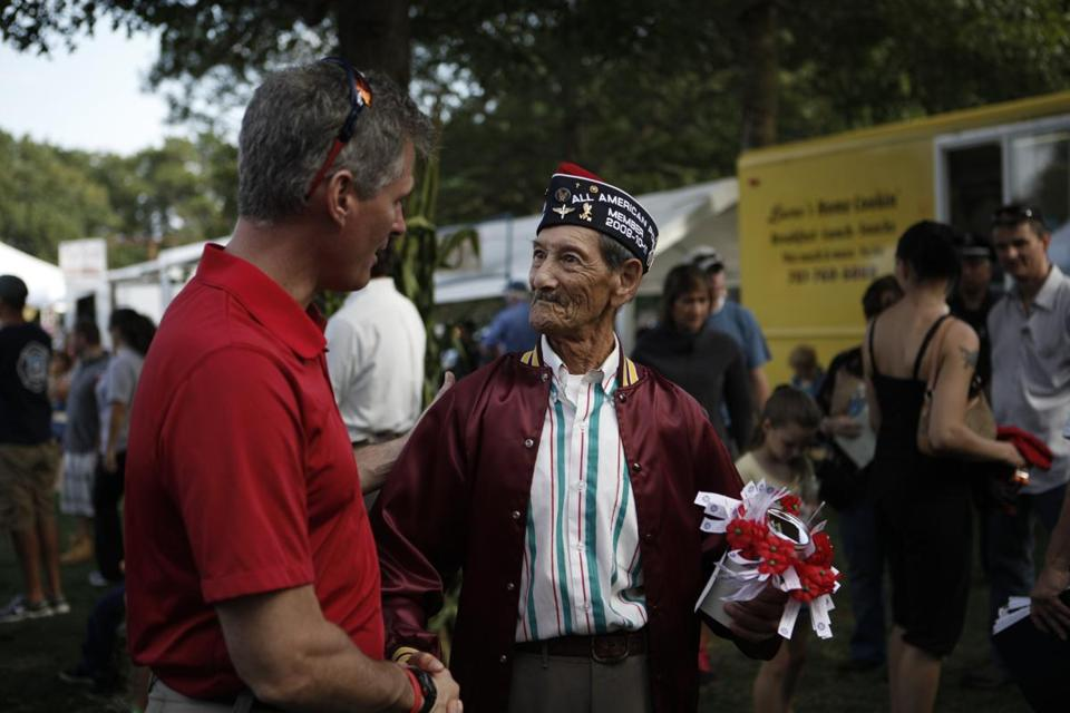 Senator Scott Brown shakes hands with Wilfred Lopez, a Vietnam war veteran, while on the campaign trail in Mashpee, Massachusetts on October 6, 2012.