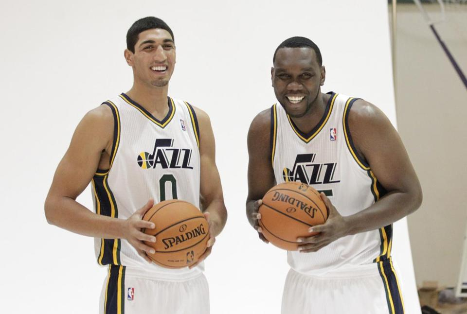 The Jazz's Enes Kanter, left, with teammate Al Jefferson during Jazz media day.